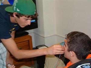 Frank carefully applies zygomatic sensors to Andrew